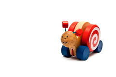 Toy snail. Children's toys - wooden snail on wheels with a rope Royalty Free Stock Image