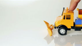 Toy snow plow. Driving forward and backward stock footage