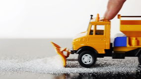 Toy snow plow. Removing snow stock video footage