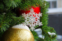 Toy snowflake hanging on the branch Stock Images