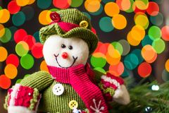 Toy snowman against festive background Royalty Free Stock Photo