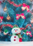Toy snowman with Christmas tree Royalty Free Stock Photos