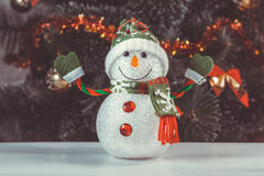 Toy snowman with Christmas tree Royalty Free Stock Photo