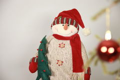 Toy snowman, Christmas tree Stock Photos