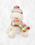 Toy snowman covered by snow Stock Images