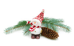 Toy snowman and fir-cone on a branch isolated on a white backgro Royalty Free Stock Images
