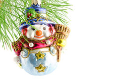 Toy snowman on the green fir-branch christmas decoration Royalty Free Stock Photography