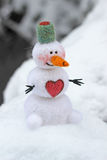 Toy snowman  with heart Stock Photography