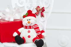 Toy snowman with red box Royalty Free Stock Photo