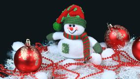Toy snowman with a red festive balls and decorations Stock Photo