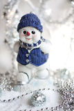 Toy snowman at the ski in snow Royalty Free Stock Images