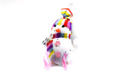 Toy snowman on skis from a pink candy striped on a white background. Christmas souvenir. Stock Photo
