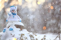 Toy snowman  in snowy forest Royalty Free Stock Photos