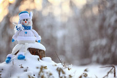 toy snowman in snowy forest Royalty Free Stock Photo