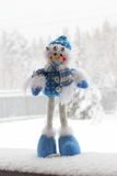 Toy snowman. In the street in winter clothes Royalty Free Stock Photo