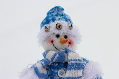 Toy snowman. In the street in winter clothes Royalty Free Stock Image