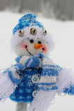 Toy snowman. In the street in winter clothes Stock Image