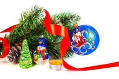Toy snowman under a branch of an artificial Christmas tree Stock Image