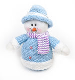 Toy snowman wearing a scarf on a white background. Cute Toy snowman wearing a scarf on a white background Stock Photo