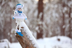 toy snowman in winter snowy forest Royalty Free Stock Image