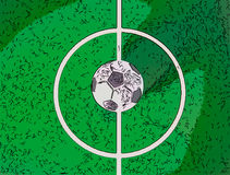 Toy soccerball in a midfield, in the center of the green field Royalty Free Stock Photography