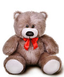 Toy soft teddy bear with bow Royalty Free Stock Photos