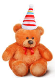 Toy soft teddy bear with bow in santa claus hat Royalty Free Stock Image