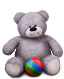Toy soft teddy bear with striped ball Royalty Free Stock Photo