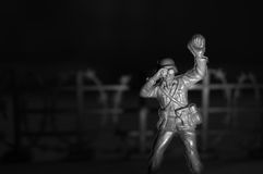 Toy Soldier. Patrolling with binoculars Stock Photo