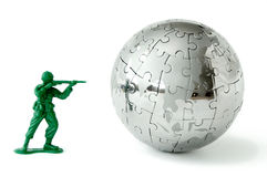 Toy soldier aiming at the world 2 Royalty Free Stock Photography