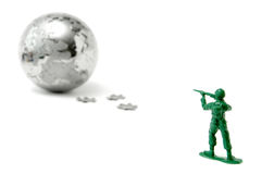 Toy soldier aiming at the world Royalty Free Stock Images
