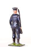 Toy soldier - Backview of toy sailor with rifle. Vintage toy sailor with a rifle on white background Stock Images