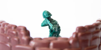 Toy soldier in cover Stock Photography