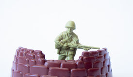 Toy soldier in cover Stock Photo