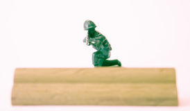 Toy soldier in cover Royalty Free Stock Photo