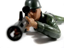 Toy soldier looks through the sight Royalty Free Stock Photography