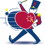 Toy Soldier. Marching while beating a heart-shaped drum Royalty Free Stock Image
