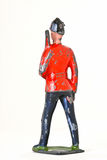 Toy soldier with rifle - Foot guard backview. Vintage toy soldier poses with rifle isolated on white background Stock Photos
