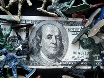 Toy soldier standing with dollar Stock Photo