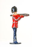 Toy soldier with Trombone - sideview. Vintage toy soldier, part of a Military band member playing Trombone isolated on white background Royalty Free Stock Photos