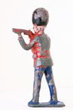 Toy soldier - Vintage foot guard with rifles. Toy soldier in shooting position isolated on white background Stock Photography