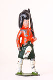 Toy soldier - Vintage foot guard with rifles. Toy soldier on white background Royalty Free Stock Image