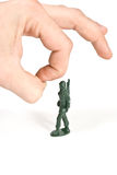 Toy soldier w hand. Toy soldier with human hand royalty free stock photography