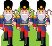 Toy Soldiers. Marching ina row holding candy canes instead of guns Royalty Free Stock Photography