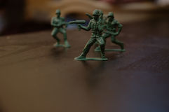 Toy soldiers. Shallow depth expressing movement Stock Photography
