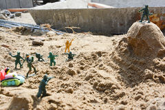 Toy soldiers. In the attack on the sand hill Royalty Free Stock Photography