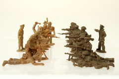 Toy soldiers battle focus in center. British and German toy soldiers struggle Royalty Free Stock Photos