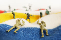 Toy soldiers on a bed Royalty Free Stock Images