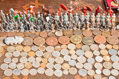 Toy soldiers and coins on a flea market Stock Image