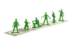 Toy soldiers on a dollar Stock Images